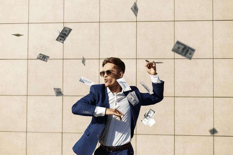 o que é um investidor imobiliário. Dançando na rua jogando dólares para o alto