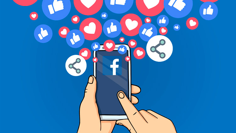 Social media imobiliária: Celular com aplicativo do Facebook recebendo várias curtidas e compartilhamentos.