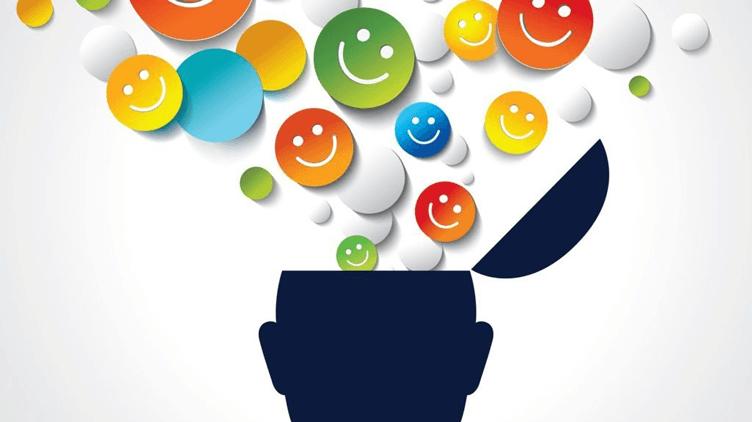 Topo de uma cabeça aberta e de dentro saindo vários emoticons positivos. Pensar motivo para trabalhar com social medias imobiliarias.