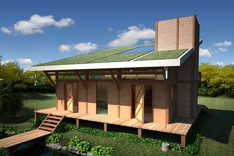 Imagem de uma casa casa ecologicamente correta. No meio do verde, com telhado solar e verde e madeira de reflorestamento.